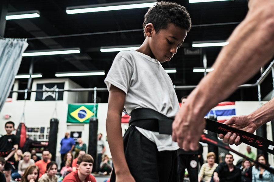 boy getting his belt